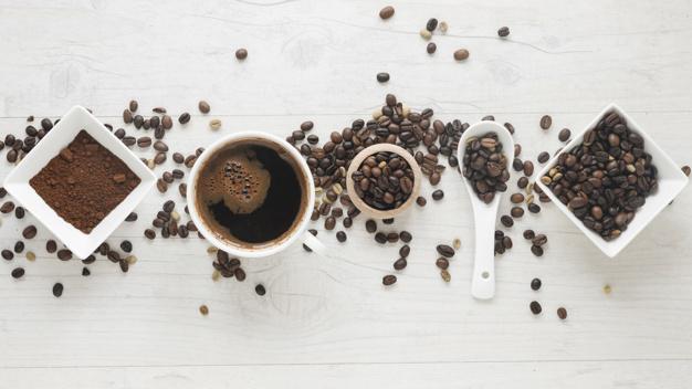 cup-coffee-coffee-powder-coffee-beans-arranged-row-desk_23-2148028167